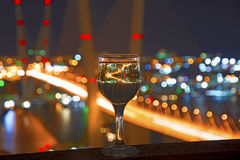 View the city at night, the bridge across the Bay at night, glasses through which the reflected/ Stock Photos