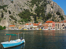View of the city Omis, Croatia, with fishing boat in the foreground Royalty Free Stock Photos