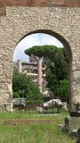 View of the city opening from one of the arches of ruins, Rome. View of the city opening from one of the arches of ruins. Antique sculptures. Nice background royalty free stock photos