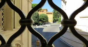 View of the city through the openwork metal fence in Rome. Italy royalty free stock photography