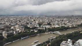 View of the city of Paris, France from top of Eiffel Tower on a cloudy day stock photos