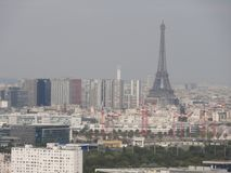 View of the city of Paris and the surroundings. Far off, we can perceive the Eiffel Tower. The Eiffel Tower is of face. Shooting in the day without character Royalty Free Stock Photography
