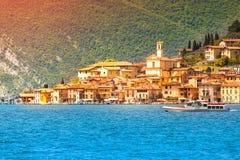 View of the city Peschiera Maraglio, a bright sunny day. Stock Photos