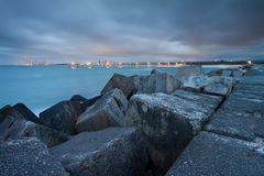 View on city and pier from rocky headland Stock Photo