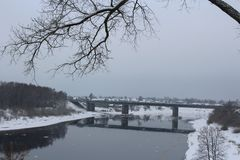 View of the city of Polotsk, Belarus. Winter landscape, gloomy gray sky, the river Polota Royalty Free Stock Photo