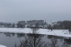 View of the city of Polotsk, Belarus. Winter landscape, gloomy gray sky, the river Polota Stock Photography