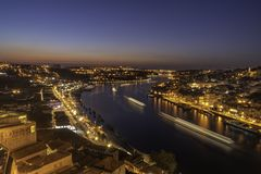 View of the city of porto in portugal from the bridge dom luis at night stock photo