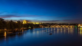 View of the city Prague in Czech Republic with colorful paddle boats day to night timelapse on the Vltava river with stock footage