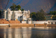View of the City of Pushkar, Rajasthan, India. Houses reflected in the water. A beautiful lake. Stock Images