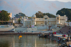 View of the City of Pushkar, Rajasthan, India. Houses reflected in the water. A beautiful lake. Stock Photo