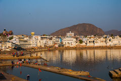 View of the City of Pushkar, Rajasthan, India. Houses reflected in the water. A beautiful lake. Royalty Free Stock Photography