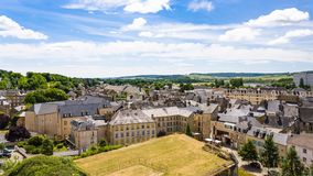 View of city from rampart of Chateau de Sedan. SEDAN, FRANCE - JUNE 30, 2010: above view of city from rampart of castle Chateau de Sedan in summer day. Sedan is stock images
