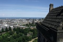 View of city from the ramparts of Edinburgh castle Princes Street gardens show green in the foreground. View city ramparts edinburgh castle princes street stock images