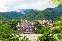 View of The City of Rishikesh and The Holy Ganges River. In India royalty free stock photography