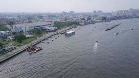 View of the city with the river on the left bank. Aerial view of the residential district. Top view of the RIVER IN the. CITY stock footage