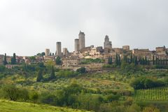 A view of the city of San Gimignano on a cloudy September day. Italy Royalty Free Stock Photo