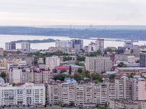 View of the city of Saratov from the mountain. The urban landscape, infrastructure, tenement houses, public buildings and streets Royalty Free Stock Photography