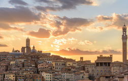 View of the city of Siena at sunset Stock Photos
