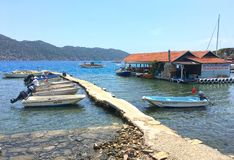 View from the city of Simena. On the island of Kekova, boats and wharf Royalty Free Stock Photos