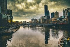 View of City Skyline Against Cloudy Sky Royalty Free Stock Photos