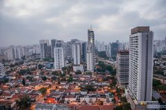 View of the city skyline in the early morning light with houses and buildings under cloudy skies in the city of São Paulo. Royalty Free Stock Photo