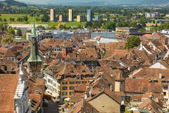 View of the city of Solothurn from the tower of the St. Ursus cathedral in summer. Summits of the Alps in the background. Solothurn is a city located in the royalty free stock images