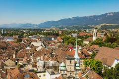 View of the city of Solothurn from the tower of the St. Ursus cathedral. In summer, summits of the Alps in the background. Solothurn is a city located in the stock photography