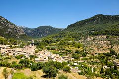 View on city Valldemossa with traditional flower decoration, famous old mediterranean village of Majorca. Balearic. Island Mallorca, Spain Stock Image