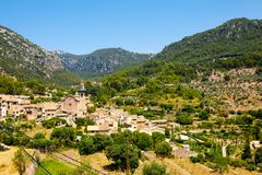 View on city Valldemossa with traditional flower decoration, famous old mediterranean village of Majorca. Balearic. Island Mallorca, Spain Stock Images