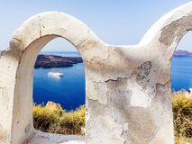 View from city wall at cruise ship in Santorini Greece royalty free stock images