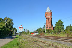 View of a city water tower of Velau and railroad tracks. Znamens Royalty Free Stock Images