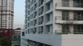 View of the city from the window of high-speed trains BTS or the Skytrain. stock video footage