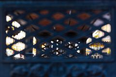 View of the city through the wrought-iron lattice. royalty free stock photography