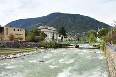 View cityscape and landscape with passer river at Meran or Merano city in Italy. View cityscape and landscape with Italian people driving car and walking on the royalty free stock photo