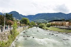 Passer river at Meran city in Merano, Italy. View cityscape and landscape with Italian people and foreigner travelers walking on the bridge crossover passer stock photo
