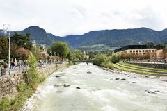 View cityscape and landscape with passer river at Meran or Merano city in Italy. View cityscape and landscape with Italian people driving car and walking on the royalty free stock images