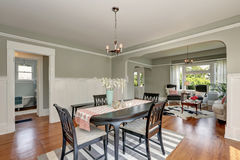 View of a classic dining room with gray walls and hardwood floors Royalty Free Stock Photo