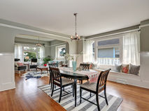 View of a classic dining room with gray walls and hardwood floors Stock Photos