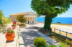 View on classical Greek temple Saint George church architecture of Greece Corfu island capital Kerkyra. Classic yacht. Greece holi. Days vacation touristic tours royalty free stock image