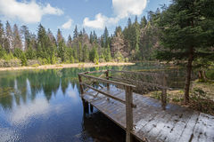 View of the clear mountain lakes and a wooden bridge Royalty Free Stock Photo