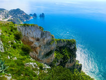 View from a cliff on the island of Capri, Italy, and rocks in sea Stock Photos
