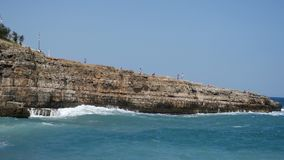 View of cliff and town of Polignano a Mare, Italy stock footage