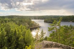 View from cliff over forest and lake. royalty free stock photo