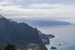 View from cliff. The view from the cliff on the small town Seixal and the shore of the Atlantic Ocean. Madeira Island, Portugal Stock Photos
