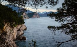 View from a cliff at sunset time near Petrovac, Montenegro royalty free stock photo