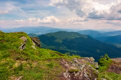 View from the cliff in to the valley. Lovely summer landscape of Carpathian mountains Stock Photo