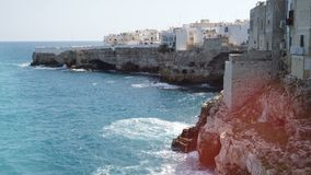 View of cliff and town of Polignano a Mare, Italy stock video footage