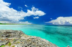 View from a cliff on tranquil turquoise ocean against blue sky magic background at Cayo Coco Cuban island on sunny nice day Royalty Free Stock Images