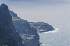 View from cliff. The view from the cliff on the small town Seixal and the shore of the Atlantic Ocean. Madeira Island, Portugal Royalty Free Stock Photos