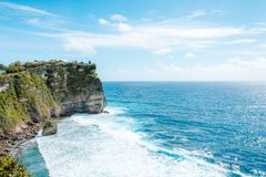 View of the cliff with waves in the sea from The Hindu Temple Pura Luhur Uluwatu stock images